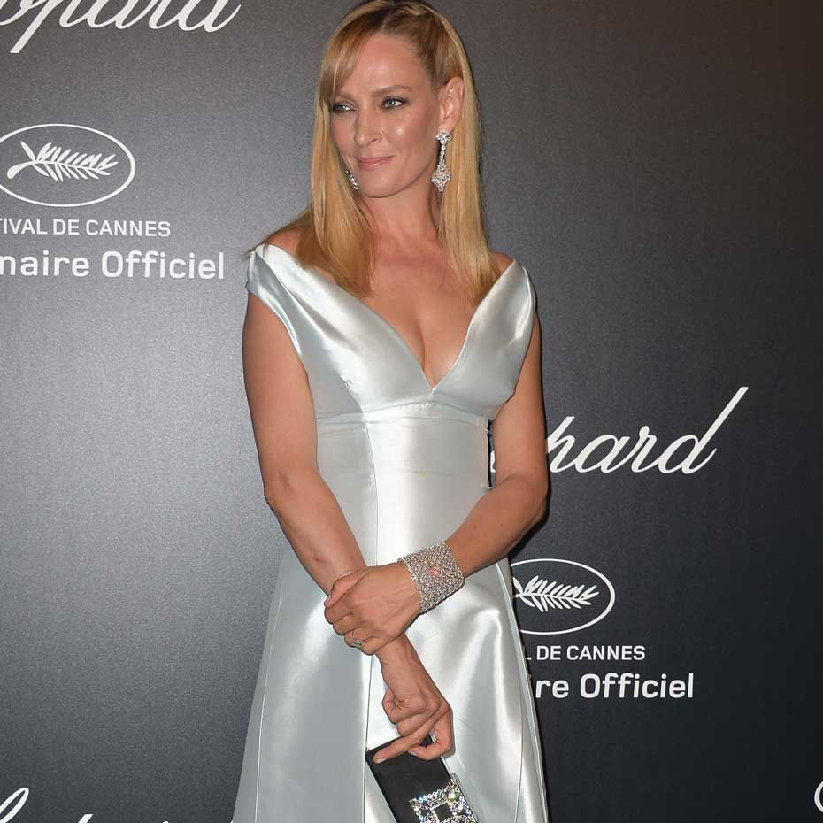 Uma Thurman shimmered in a white Prada dress and Chopard jewellery at the Swiss jeweller's GOLD party at this year's Cannes Festival. The actress wore diamond earrings as well as a stunning 84ct diamond bracelet, both from Chopard's Red Carpet high jewellery collection.