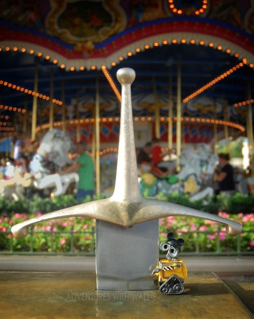 WALL-E pulls the sword from the stone.