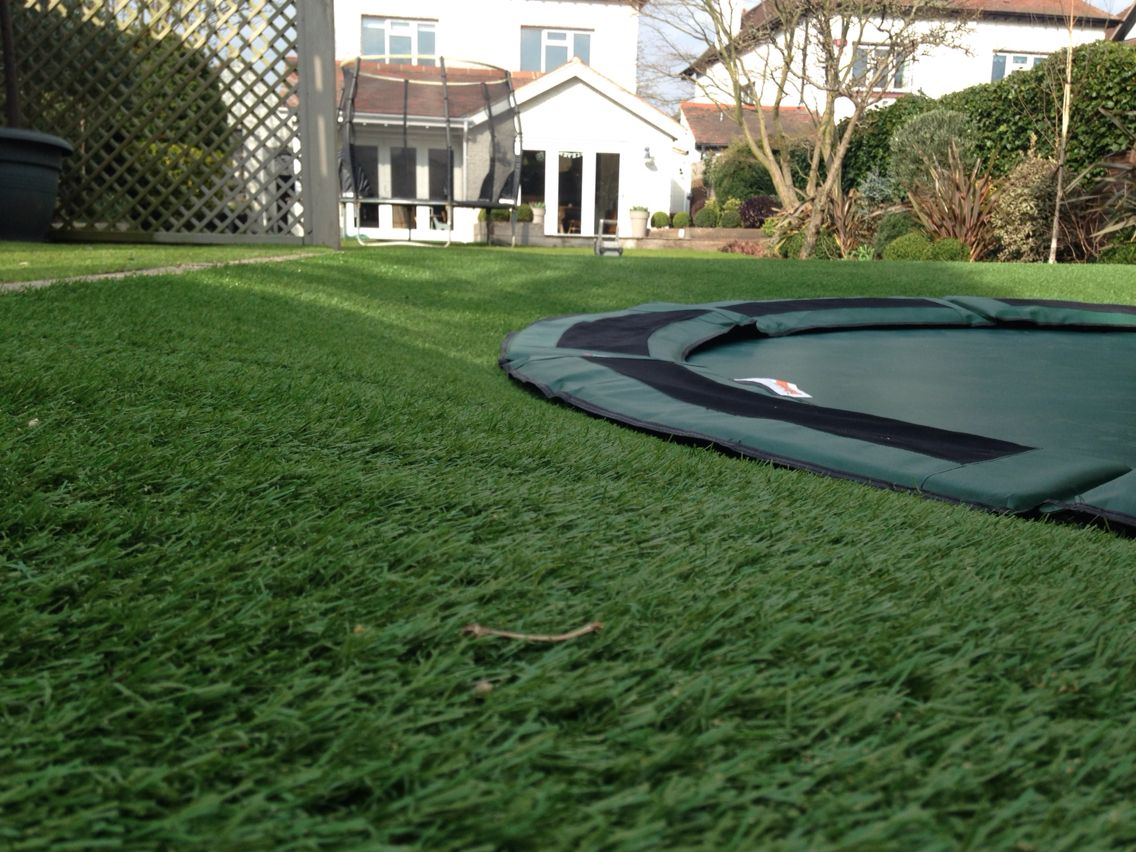 sunken trampoline with astroturf with rolling edges garden