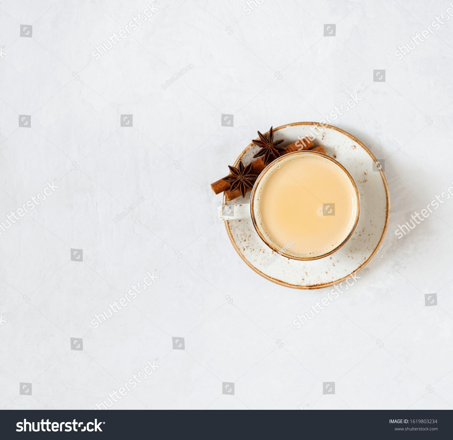 Indian Masala Chai Tea Traditional Indian Hot Drink With Milk And Spices On White Concrete Background Top View Flat In 2020 Masala Chai Tea Hot Spices Masala Chai