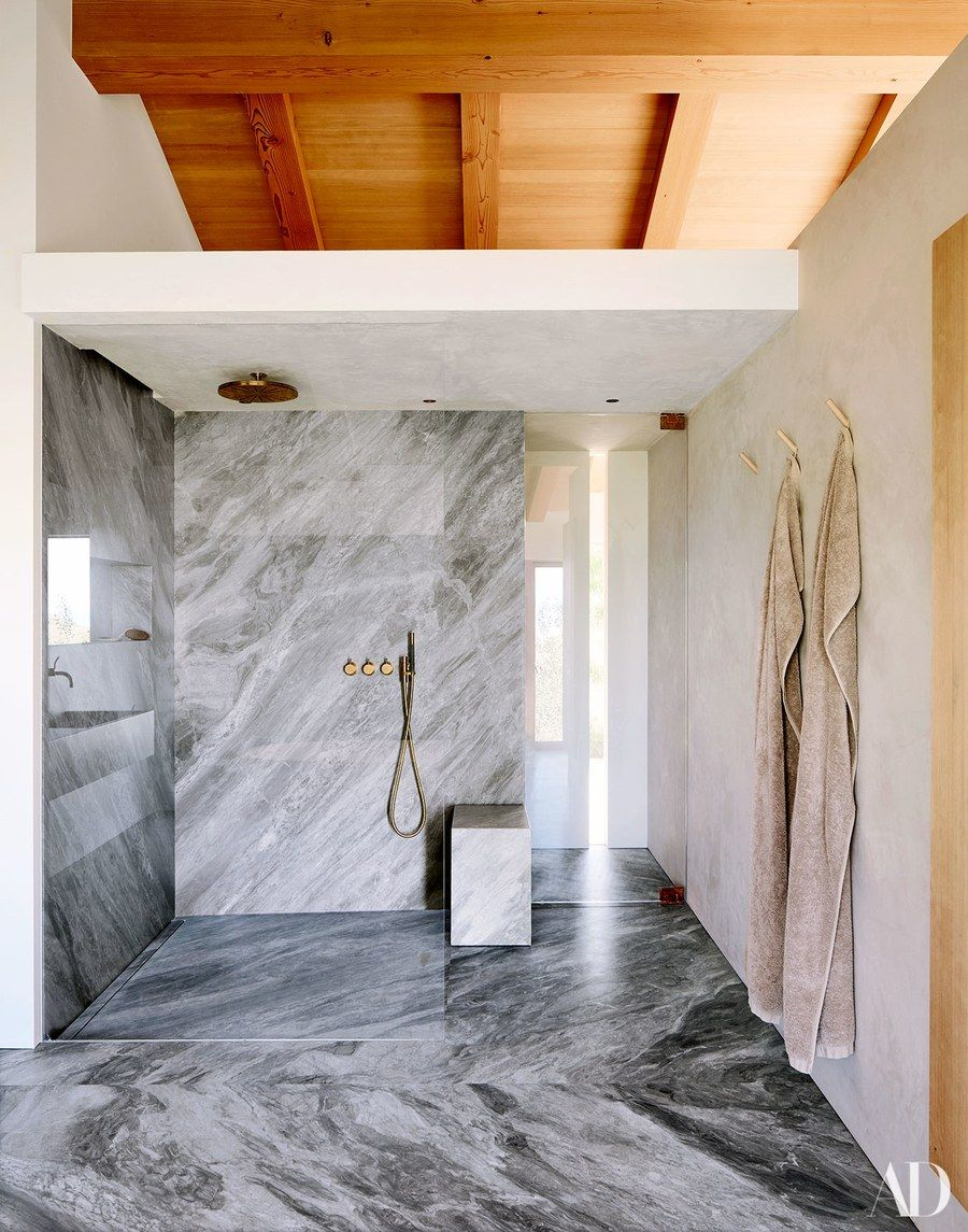 The master bathroom is sheathed in Versalys
