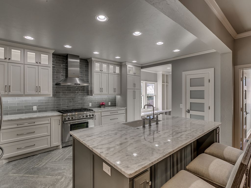 Transitional Kitchen With Cloud Vein Cut Deep Brushed Field Tile, Hanover  Flat Panel Cabinet Door