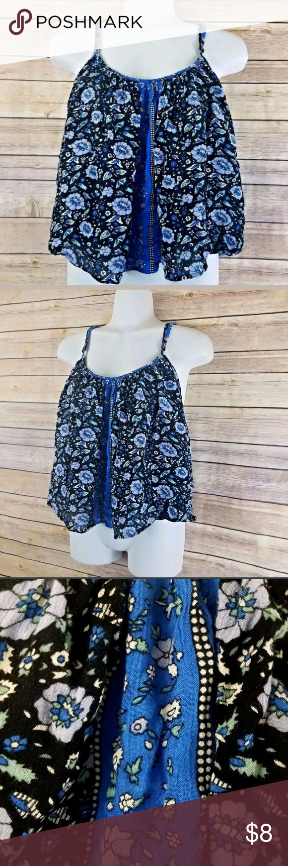 Floral Swing Tank Semi Crop M XXI Black Blue Black and blue floral swing semi cropped tank top with adjustable straps.Perfect for summer!  Brand:XXI Size: Medium  Measurements (approximate):  Chest:43 inches Waist:68inches Length: (from neckline down)15.25 inches  Condition:Pre-loved. No holes, rips, or stains. Fray on one strap. Forever 21 Tops Tank Tops