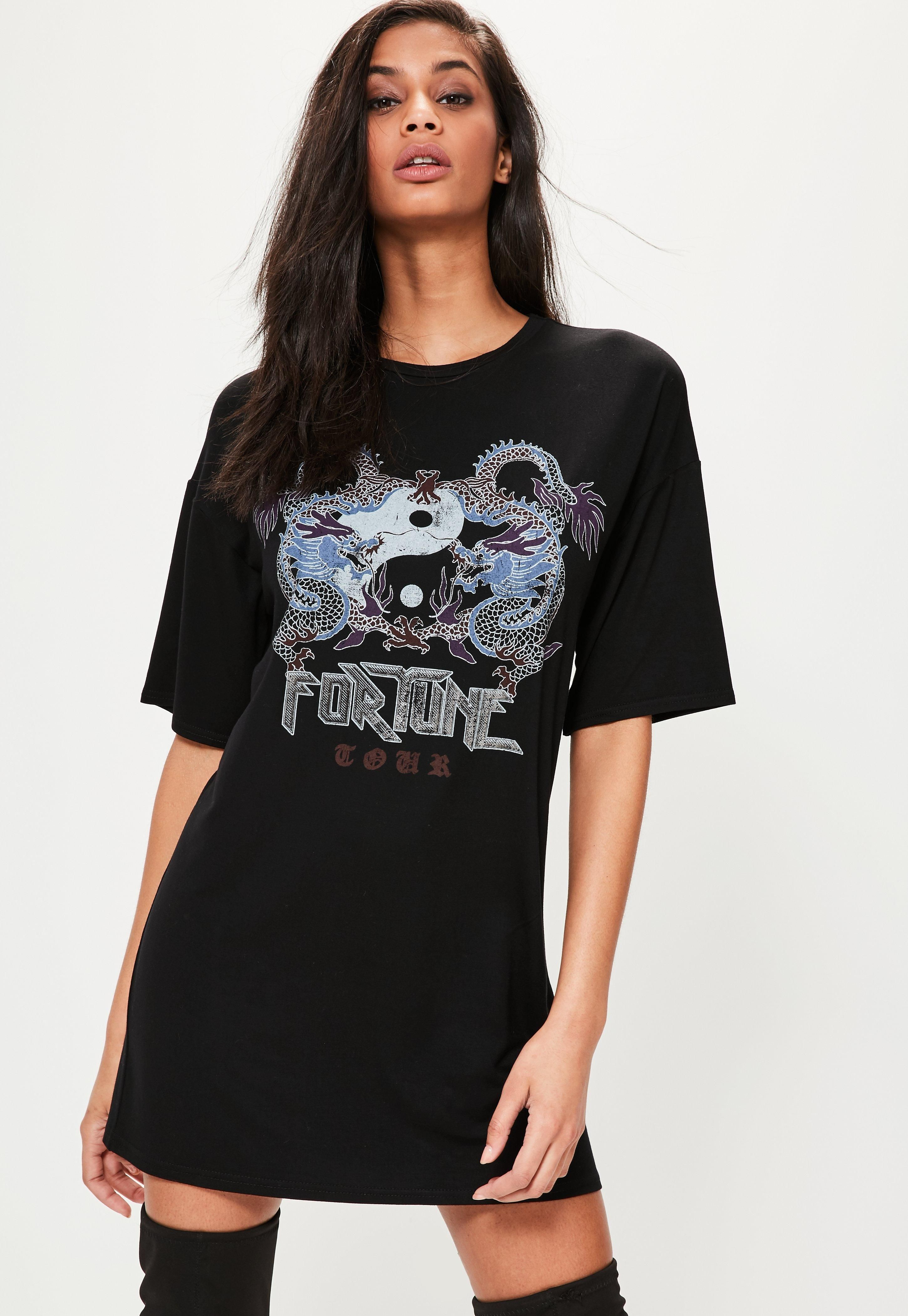 db025034267 Get wrapped up and release your inner grunge wearing this tshirt dress -  featuring a corset back, graphic print and oversized fit.
