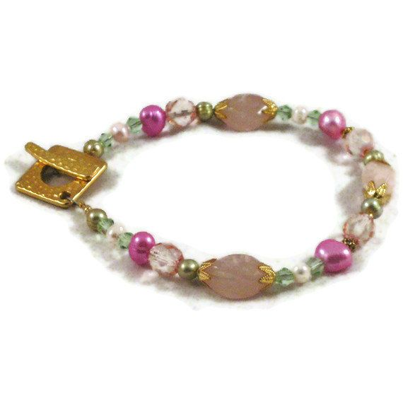 Visit Cindy's Shop for this handmade bracelet. This beaded bracelet is 8 inches and is made of rose quartz with soft rose freshwater pearlgreen and pink glass. Cindy is a retired nurse who now has her own Etsy shop.