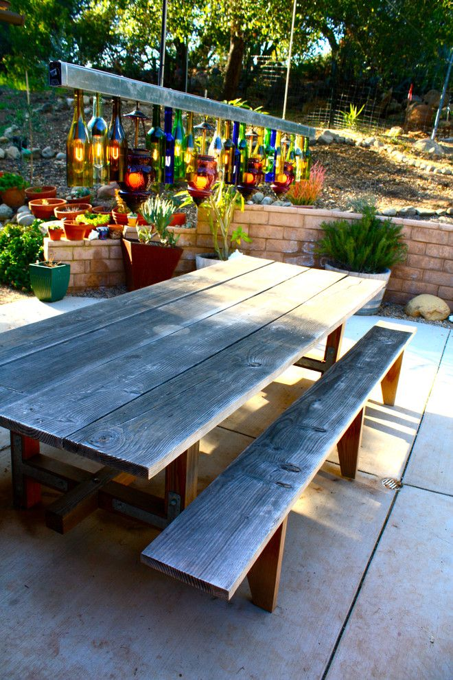 Eclectic patio design with reclaimed wood dining