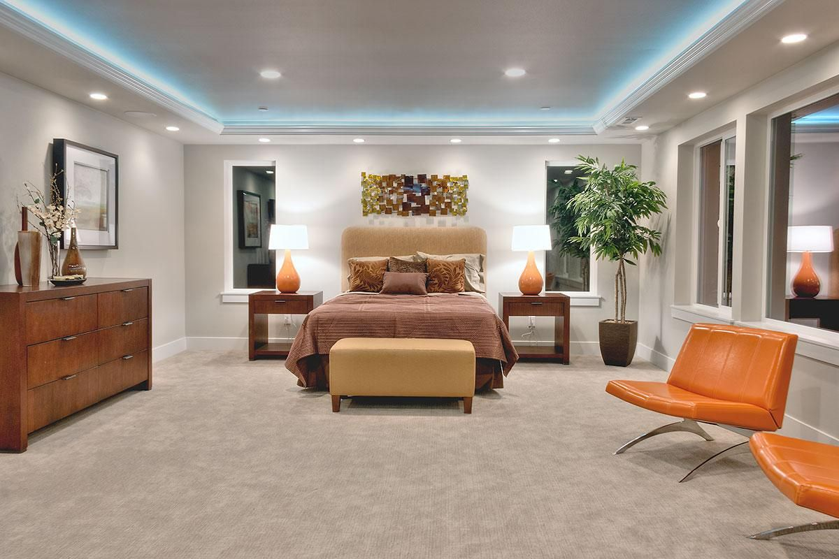 Master bedroom with coffered ceiling and recessed cove lighting