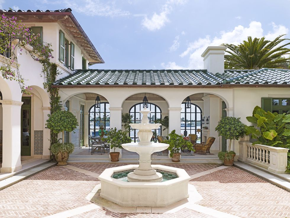 These 28 Beautiful Patio Ideas Have Us Dreaming Of Lazy Summer Days And Outdoor Entertaining In 2020 Spanish Style Homes Patio Spanish Style