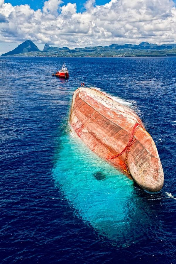 The Sinking - Taken from a helicopter, this is an image of a ship that sank in dangerously shallow water off Saint Lucia , was then raised and towed to deeper water and sunk. You can see the Gros and Petit Pitons in the background.