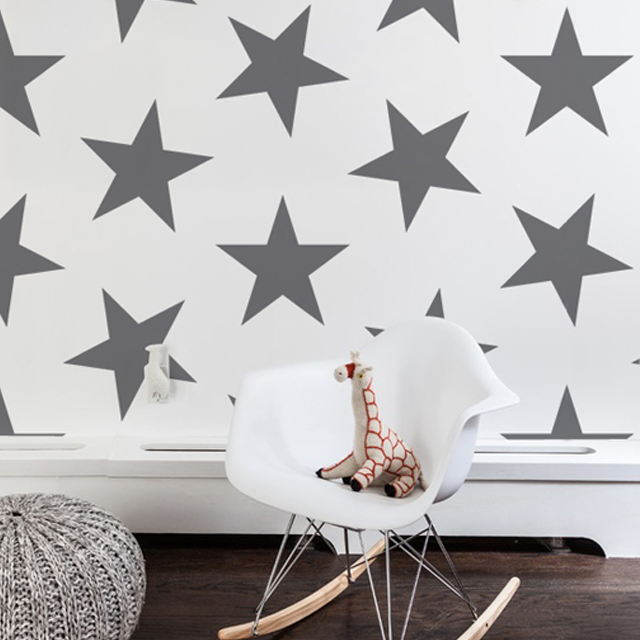 This Nursery Wallpaper Has Us Seeing Stars Love The Oversized Gray And Silver To