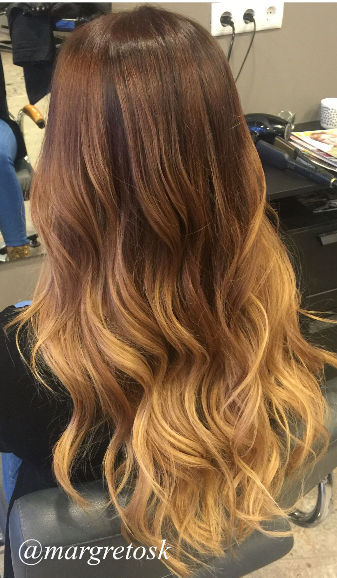 auburn red color ombre dark roots to a lighter golden