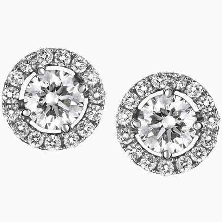 19e496a5009b Suárez  Pendientes de oro blanco con diamante central y orla de brillantes.  0