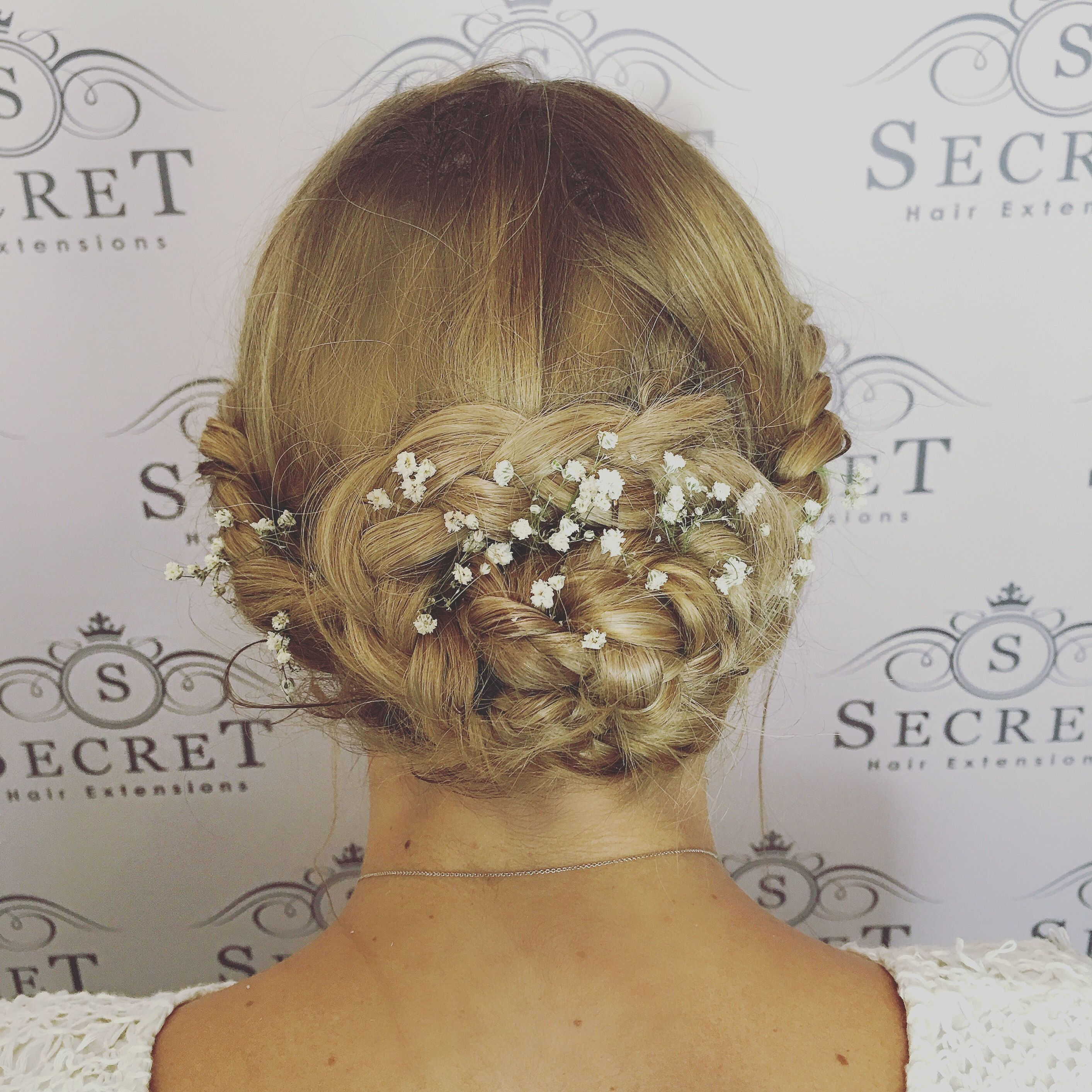 Bridal festival style braided up do created using micro ring hair extensions from Secret Hair UK