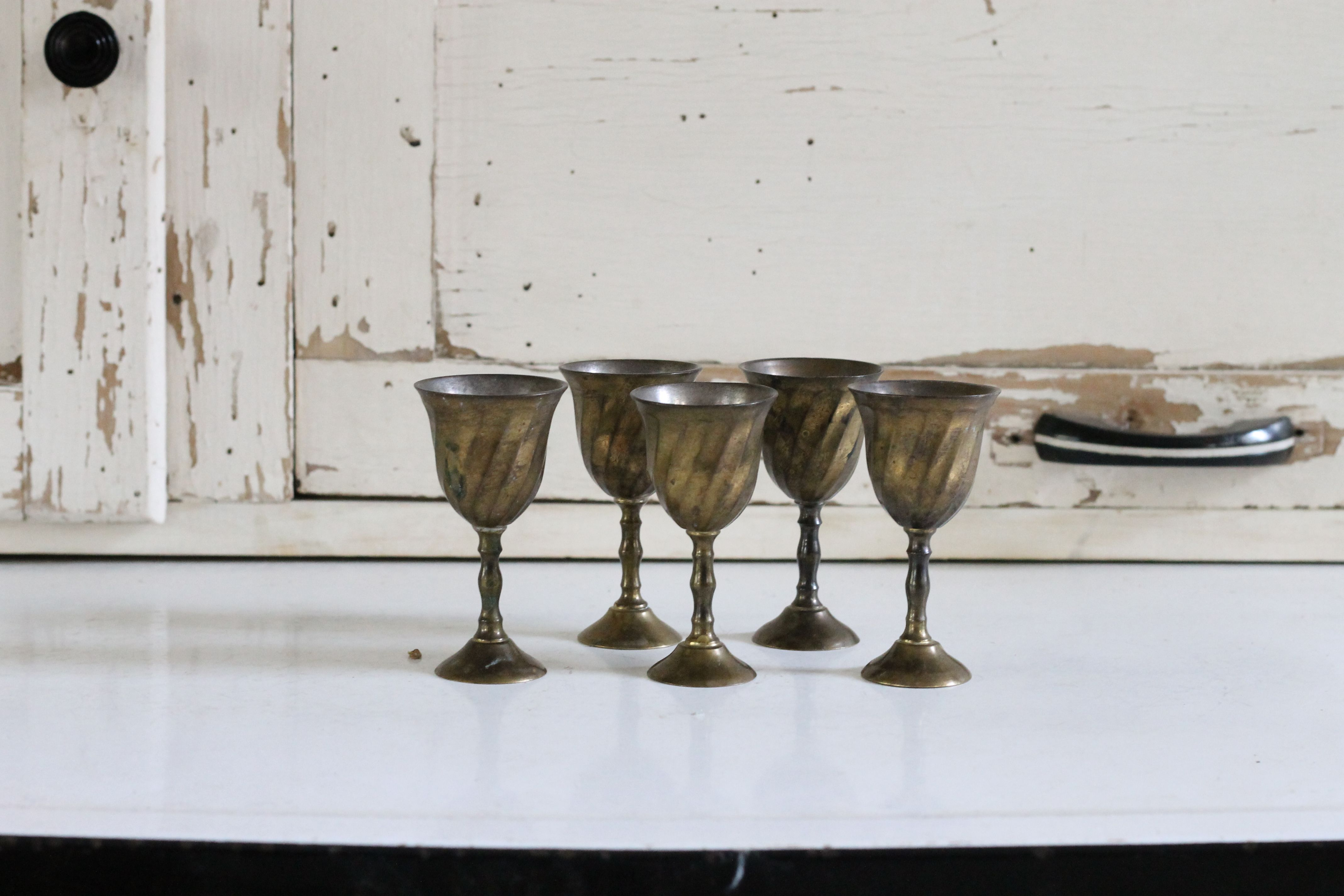 small brass goblets - good for small florals or feathers from Southern Vintage, rent for your vintage wedding or event