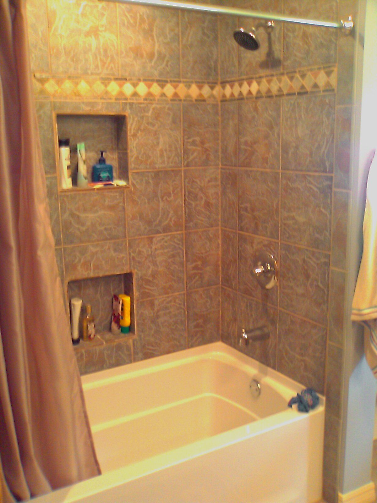 Fiberglass tub with tile surround and shampoo niches for Tub tile surround ideas