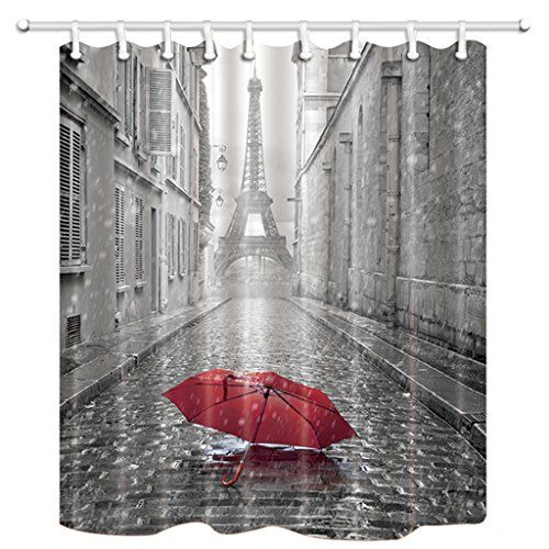 Black And White Photography Of A Moody Rainy Parisian Cobbleston Street With La Tour Eiffel In The Background Single Red Umbrella At Front