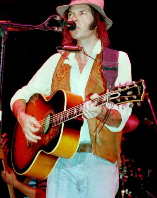 Neil Young in the 80's on his Gibson-J200