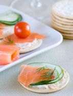 Serve this easy, no-cook smoked salmon appetizer before any dinner or as a cocktail party hors d'oeuvre. Three crackers have only 117 calories, but contain omega-3 fats and 6 grams of protein.