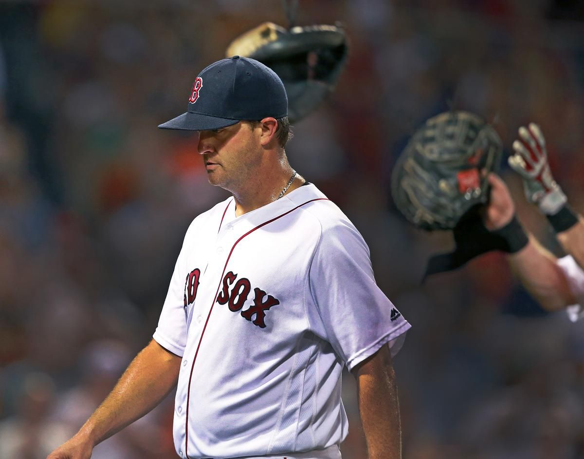 07/06/16: Boston, MA: Red Sox knuckleballer starting pitcher Steven Wright was removed from the game in the top of the seventh, and as he left, Boston catcher Ryan Hanigan caught the new mitt he was just tossed by Sandy Leon from the dugout that he would use to catch incoming hurler Tommy Layne. After he caught it, he tossed back the over sized mitt he was using while catching the knuckleball. The Boston Red Sox hosted the Texas Rangers in regular season MLB baseball game at Fenway Park…