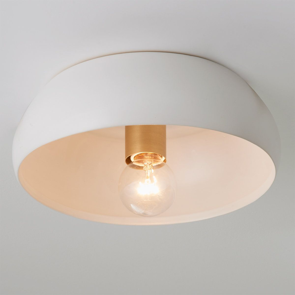 Soothing tones and soft organic shapes define the look of this matte hand glazed ceramic ceiling light. Assembled by hand in our Richmond, Virginia production facility with solid brass hardware, this ceiling light is a great example of quality craftmanship that is sure to stand the test of time.