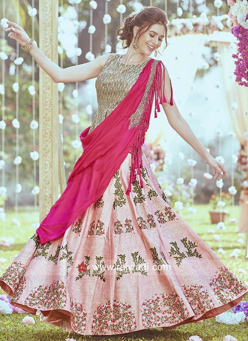 c59018760f2019 Gorgeous Raw Silk Peach pleated Lehenga comes with stylish embroidered  Choli. Deep Pink pleated dupatta attached with choli features embroidery  work with ...