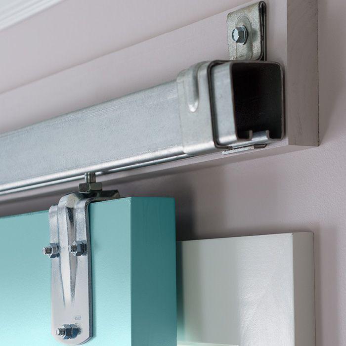 Sliding door hardware on a ledger board. Instead of fastening the ...
