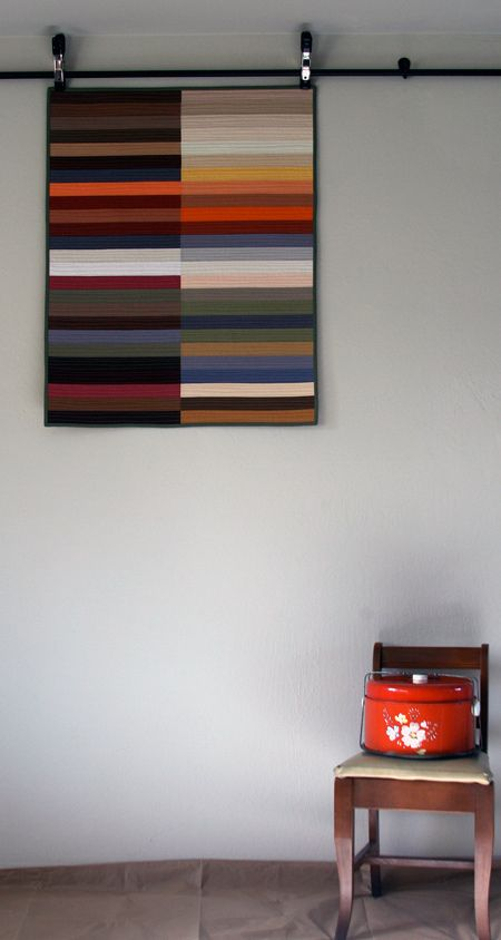Simple and elegant. Interesting hanging art quilt.