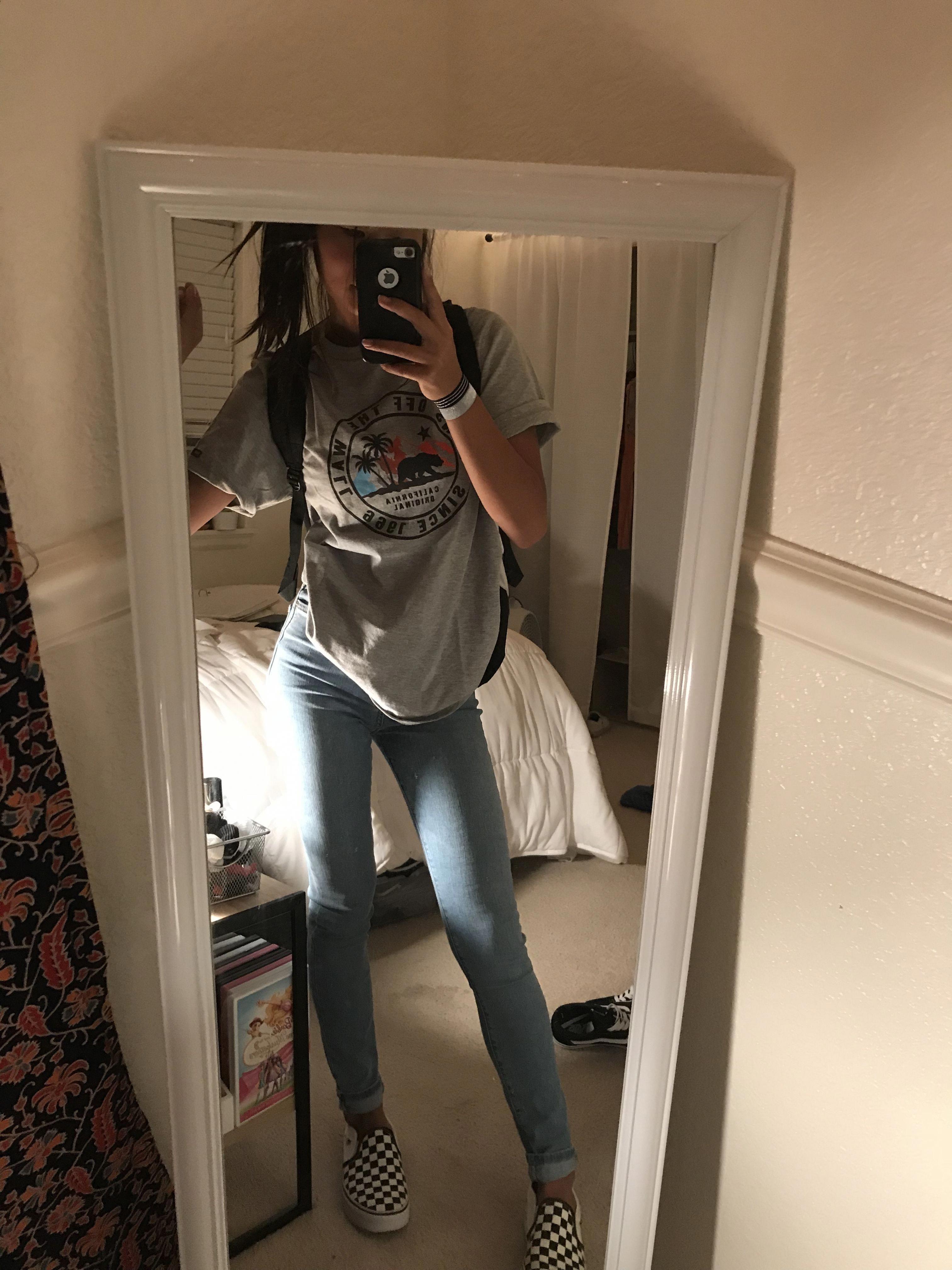 vans tee; light wash skinny jeans; checkered slip on vans