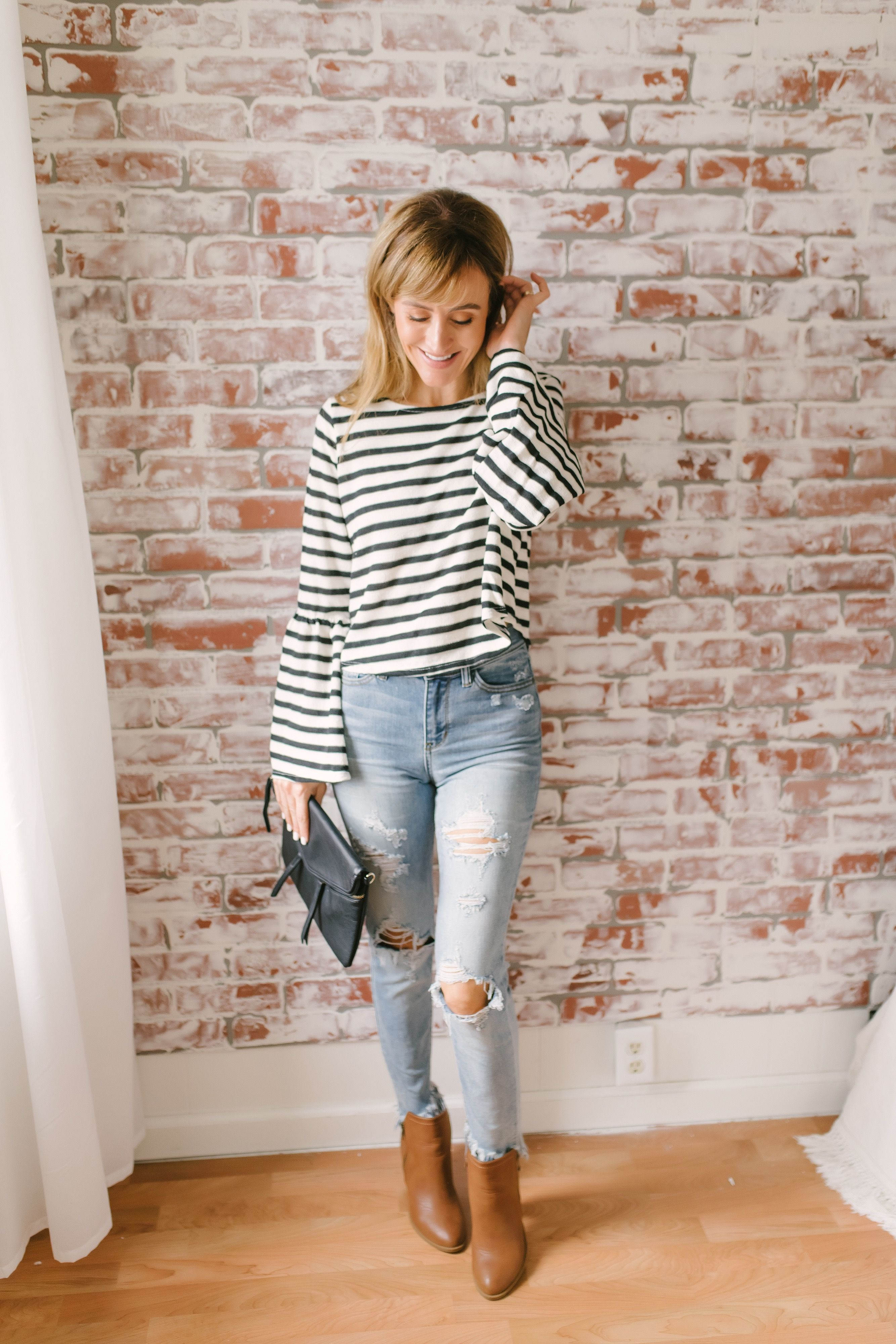 aae46da98c This striped top features long bell sleeves and comes in a cropped style.  Pair with flare jeans