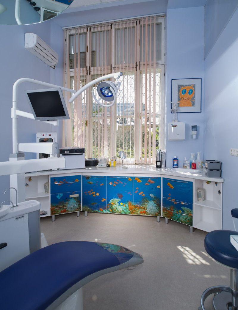 The aquarium theme on the medical furniture fa ade for Blue fish dental
