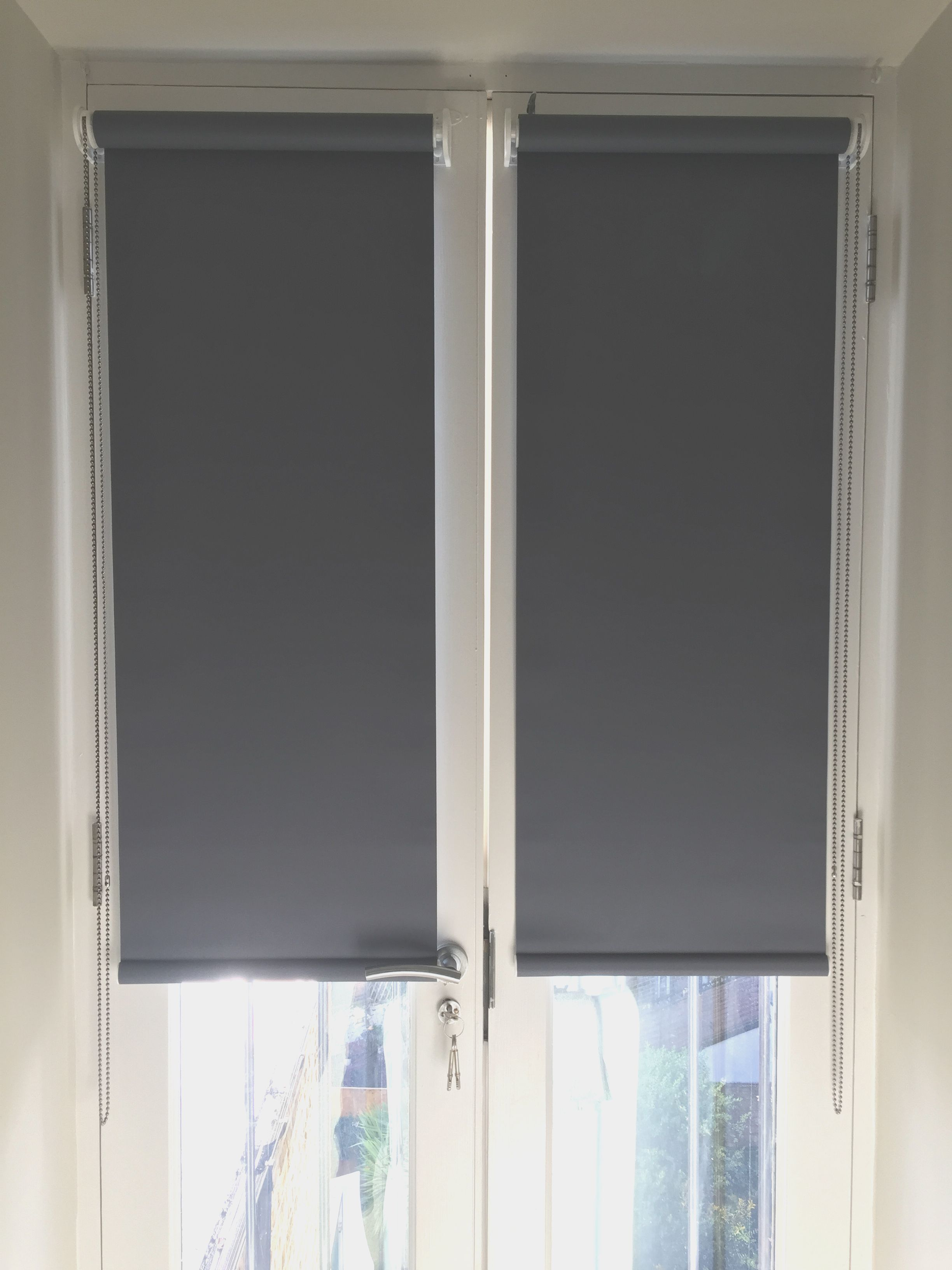 Blackout Roller Blinds For French Doors Installed To Home In Wandsworth London Made In The Uk Made To M Blinds For French Doors Door Blinds Door Coverings