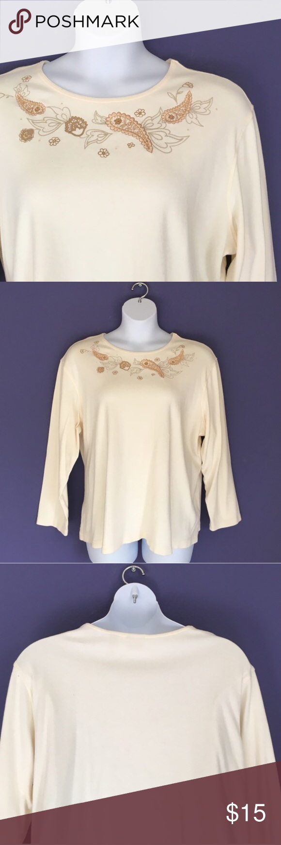 "Cream Shirt w/Embellished Neckline This casual and comfortable short is perfect for the weekend.  The embellished neckline adds a little fun.  Wear with jeans and relax.  Material:  100% Cotton. Measurements:  Length - 26""/Bust - 27"" Classic Elements Tops"