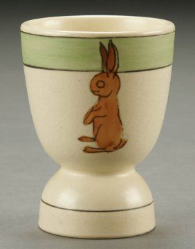 A FINE ROSEVILLE JUVENILE POTTERY EGG CUP; circa 1920; decorated with a rabbit. Height 3.5 inches.