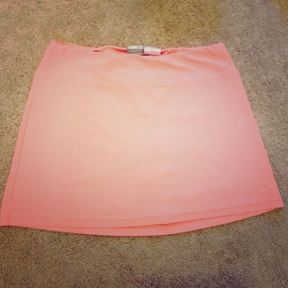 Cute Nike Coral Tennis Dryfit Skort! In awesome condition! Just has a small  black