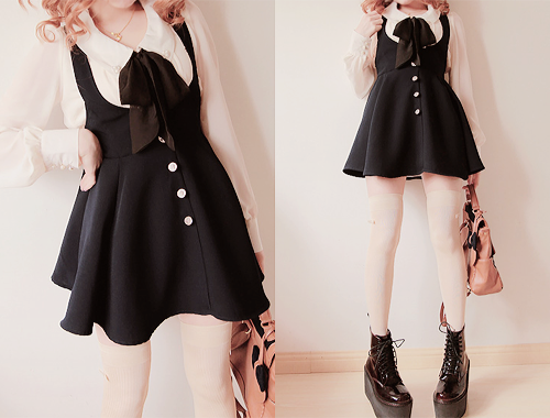 A Very Cute Black Dress With The Interesting White Collar