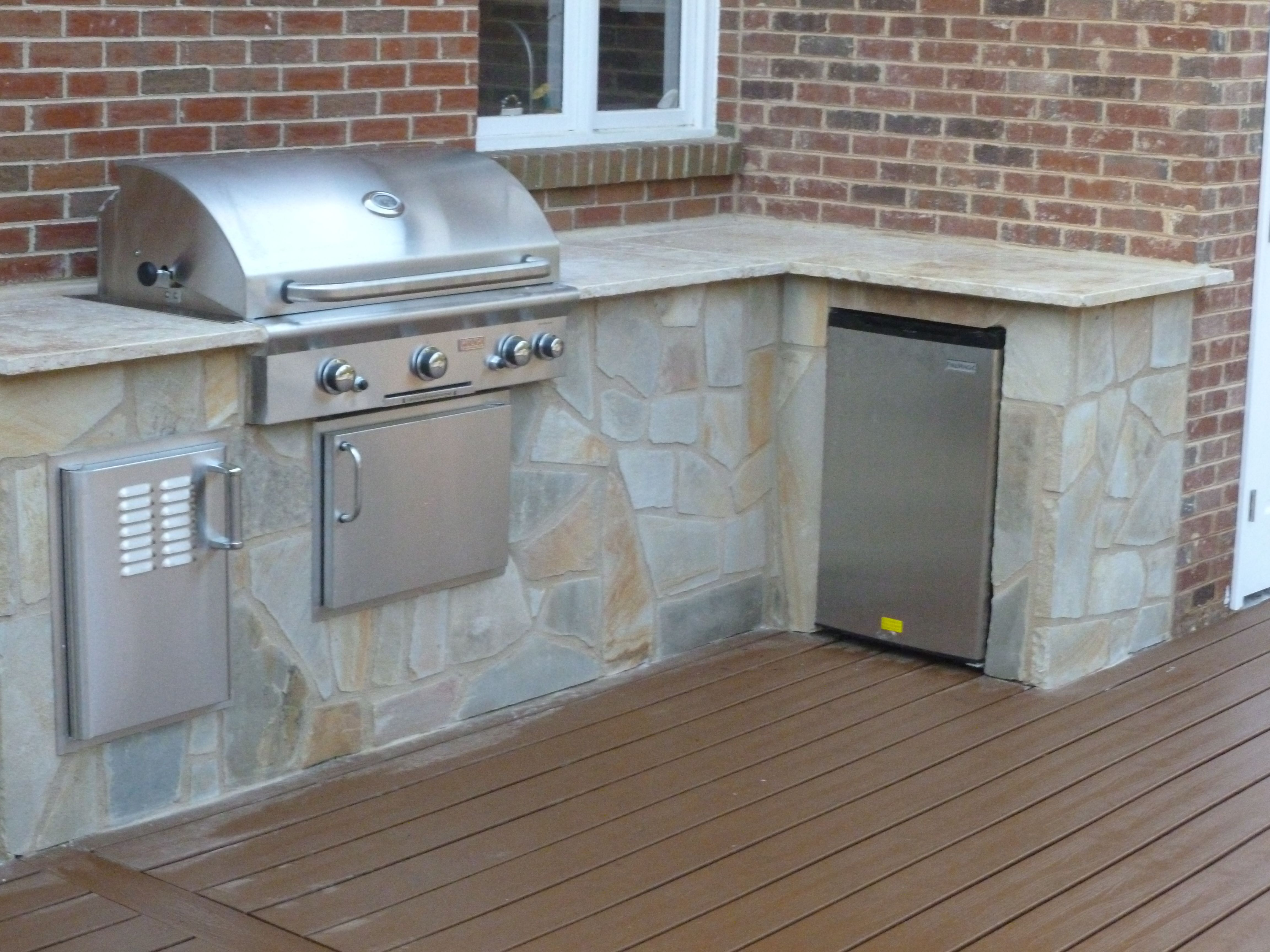 Fieldstone Outdoor Kitchen With Fire Magic Refrigerator Travertine Tile Counter Top An Outdoor Kitchen Appliances Outdoor Kitchen Countertops Outdoor Kitchen