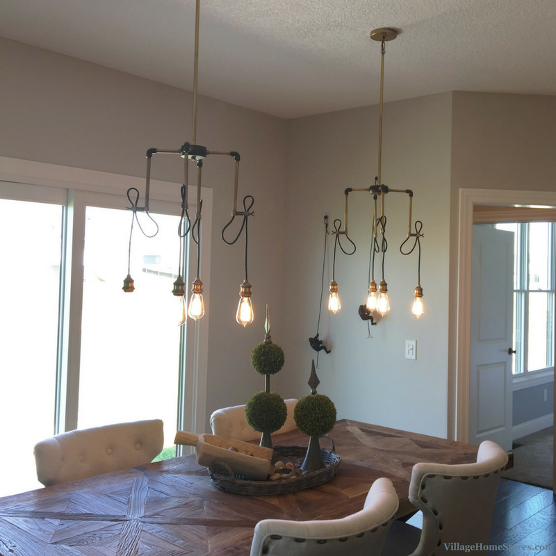 Two 4Light #chandeliers Hang Above A Dining Room Table In A Best Aspen Home Dining Room Furniture Review