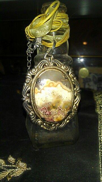 Stone pendent w/little bottle