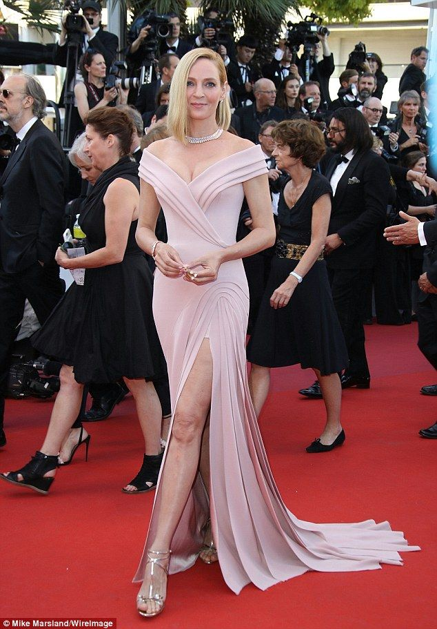 301a1e86b0 A vision in pink  The 47-year-old actress opted for retro Hollywood glamour  as she sizzled in a plunging pink gown from Atelier Versace Fall 2016  Couture ...