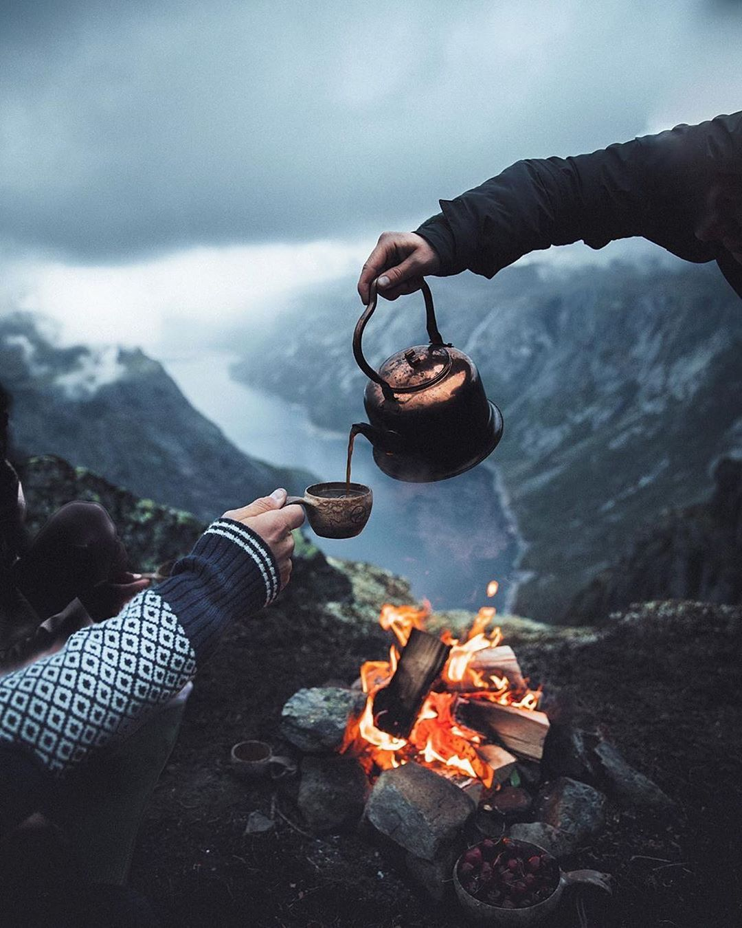 """ROAM THE PLANET on Instagram: """"Summer evenings by the fire, overlooking a huge Norwegian Fjord, it can't get any better!"""