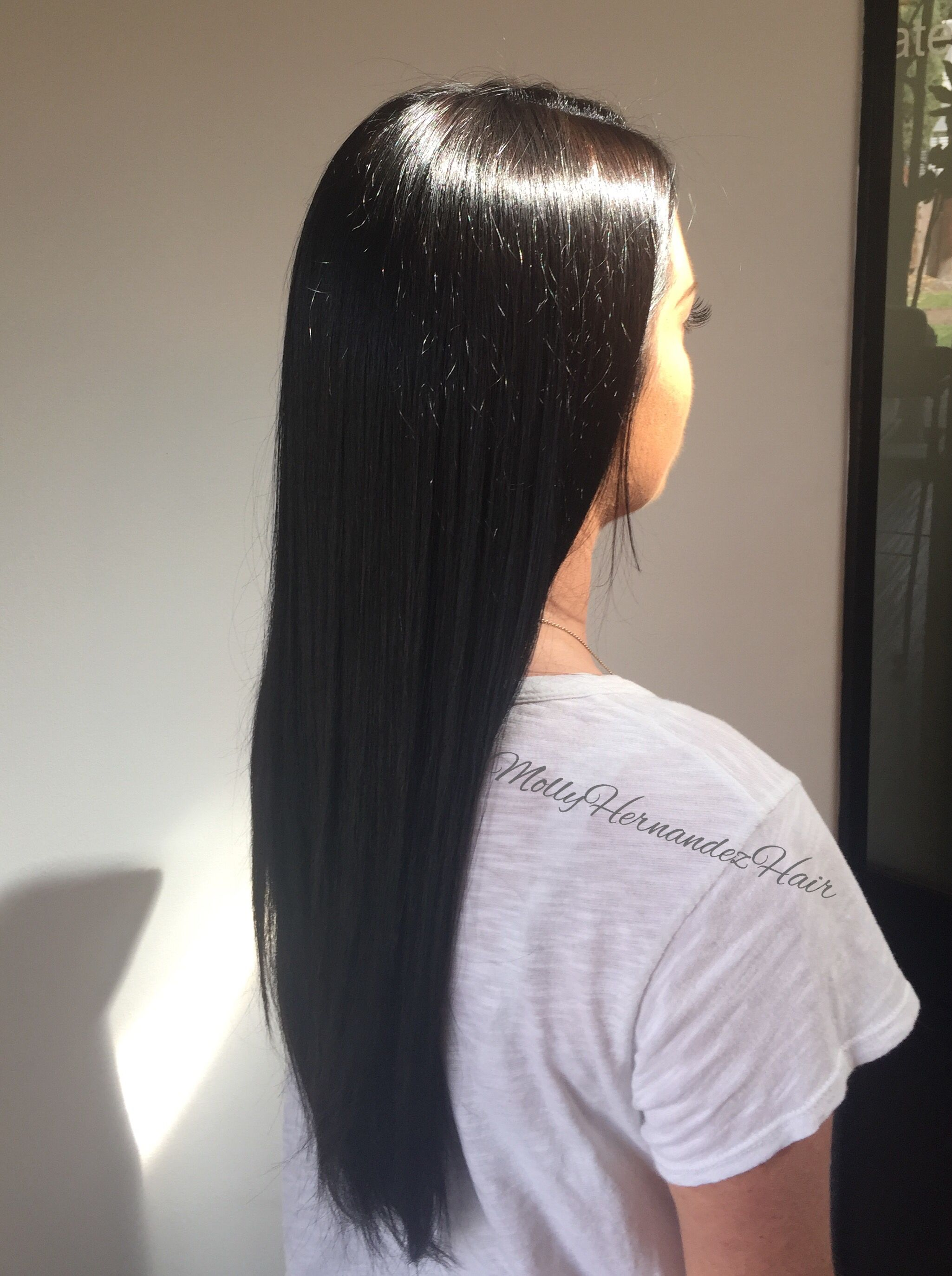 Dark brown hair, long dark hair, brownish black hair, sleek hair