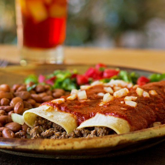 Restaurant style enchiladas with beef and chorizo, smothered in red chile sauce.