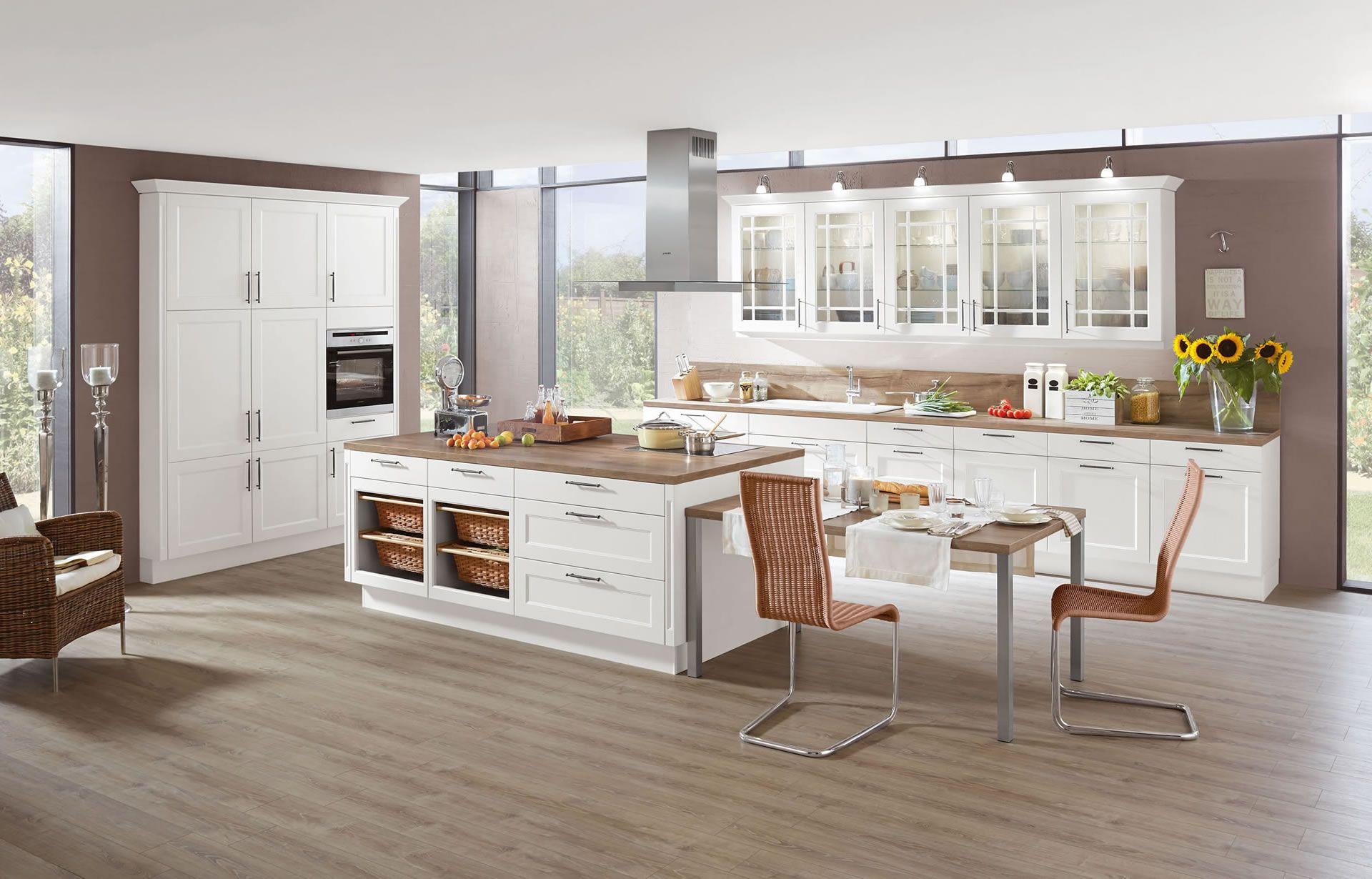 Odina/Nobilia kitchen - ivory cabinets, dark wood-effect laminate ...