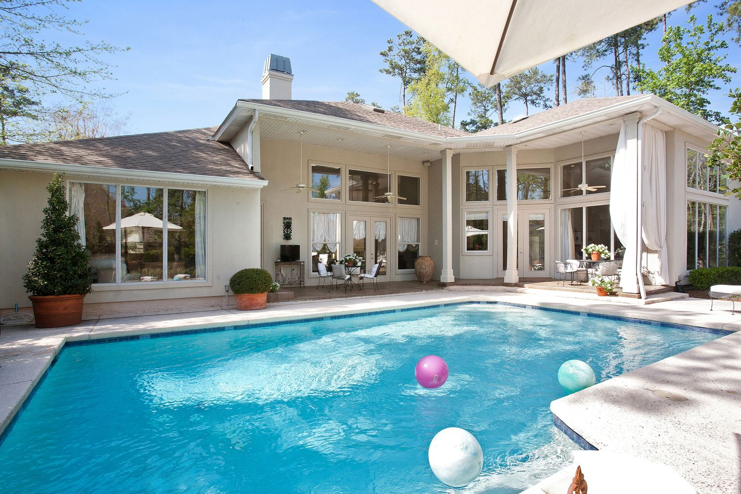 a beautiful photo of a client u0027s backyard with a pool which we