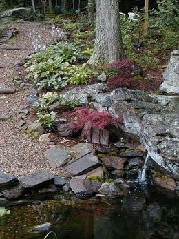 Building A Small Backyard Pond Around Rocks And Under 400 x 300