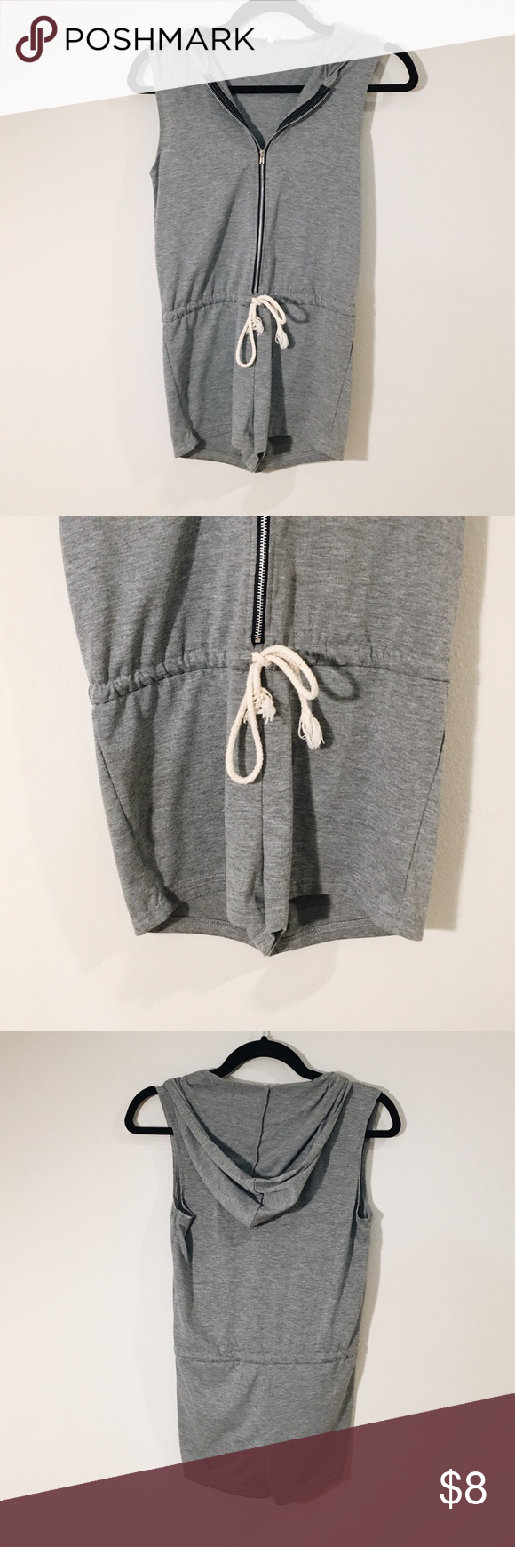 Gray Zip Romper Head to the beach in this laidback romper fashioned with a hoodie and drawstring waist. Tag says S, but better fit for XXSP Swim Coverups