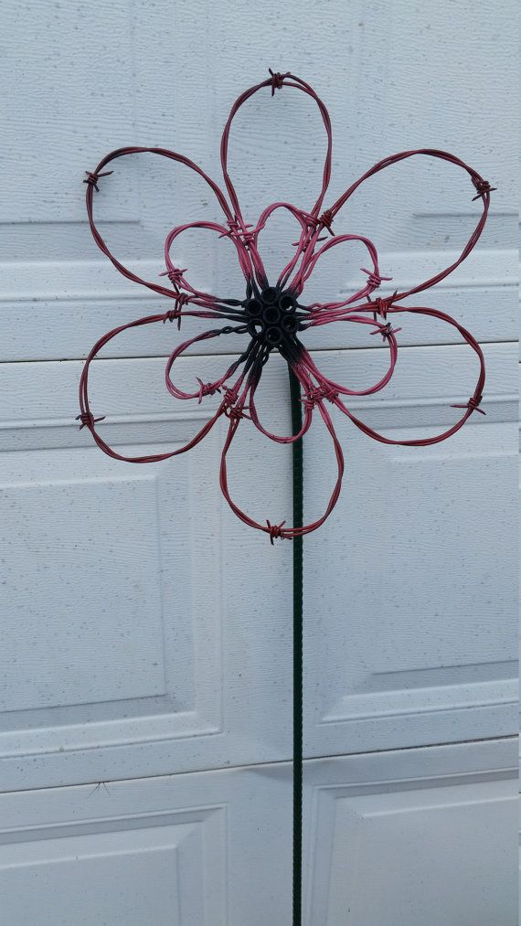 Outdoor lawn and garden decor made is barb wire and other recycled ...