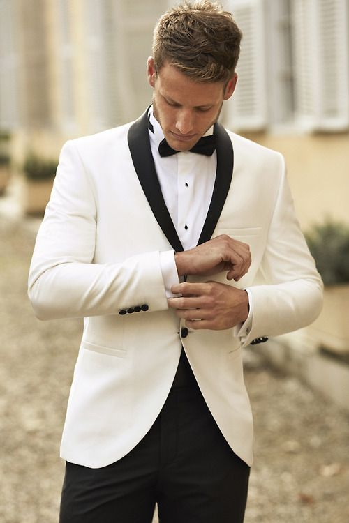 The white dinner jacket paired with black bow tie and black tuxedo ...