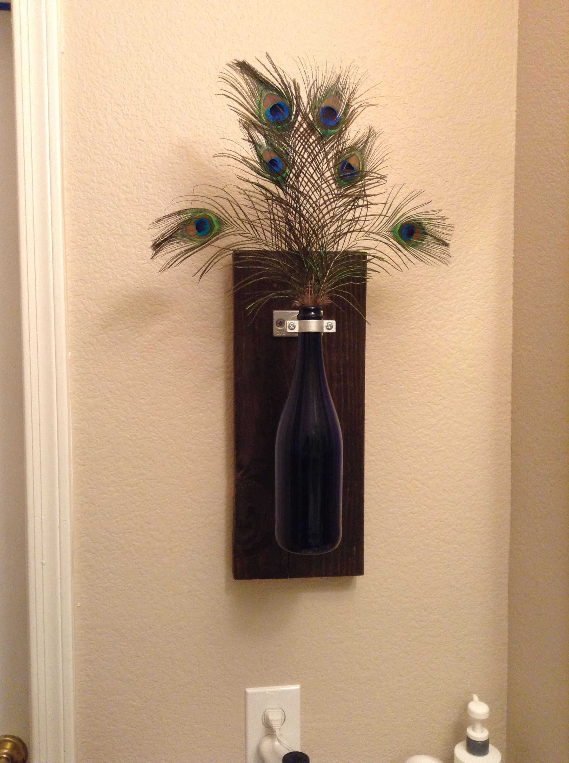 Wine bottle wall decor but because my bathroom is peacock for Peacock bathroom ideas