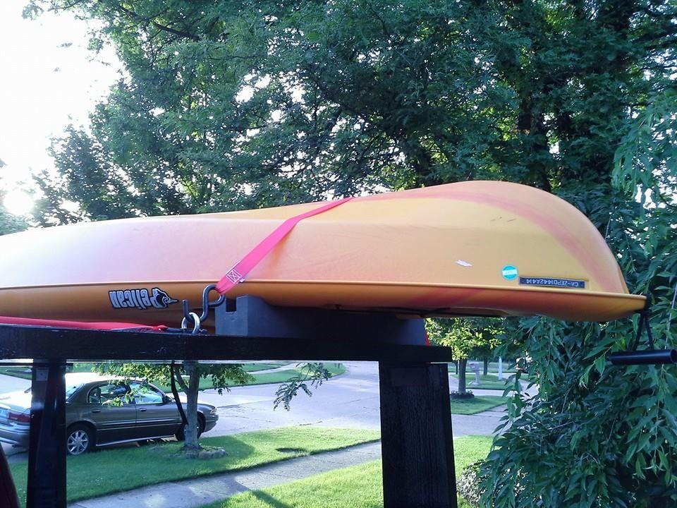 New DIY kayak rack showing strap over kayak to eye bolt in